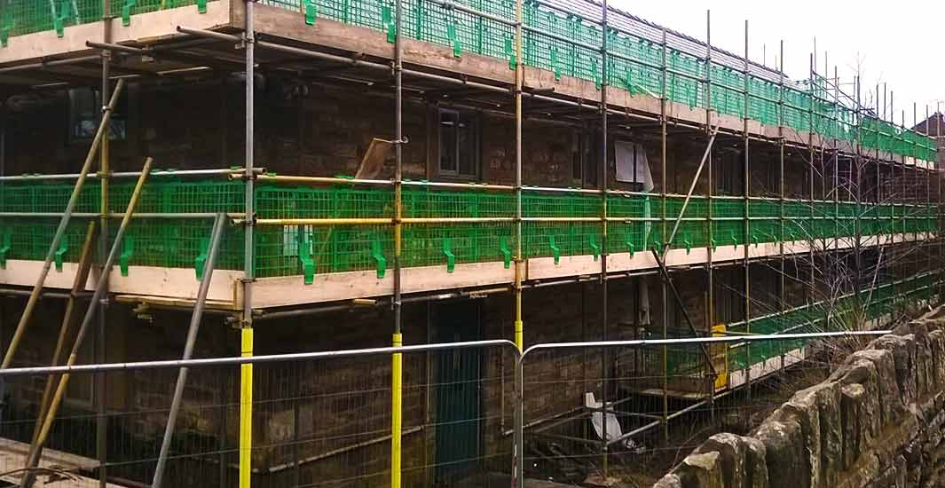 brook scaffoldings specialists erecting scaffold around an unusually shaped stone building