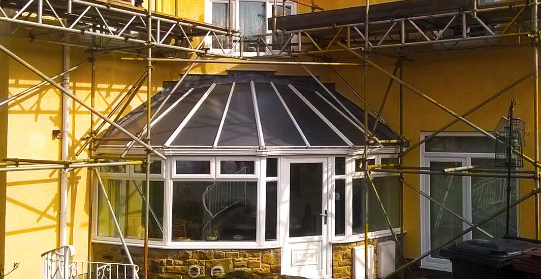 close up front view of a very attractive sheffield beige domestic property undergoing building work via brooks scaffolding erected around the entire property