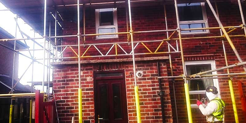 close up view of a small semi detached home fully surrounded with scaffold all installed by brook scaffolding of sheffield