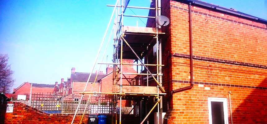 brook scaffoldings sheffield scaffolders erecting scaffold around a bright brick building